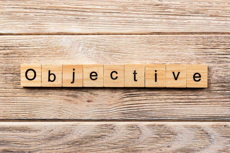 Palavra objetiva escrita no bloco de madeira texto objetivo na tabela, conceito fotos de stock
