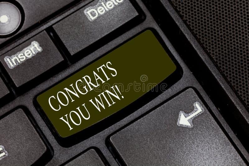 Palavra que escreve o texto Congrats que você ganha E fotografia de stock royalty free