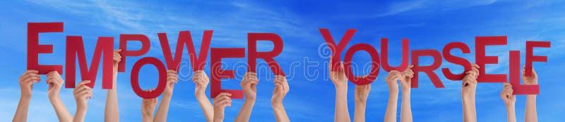 A palavra vermelha da posse das mãos autoriza-se céu azul fotos de stock