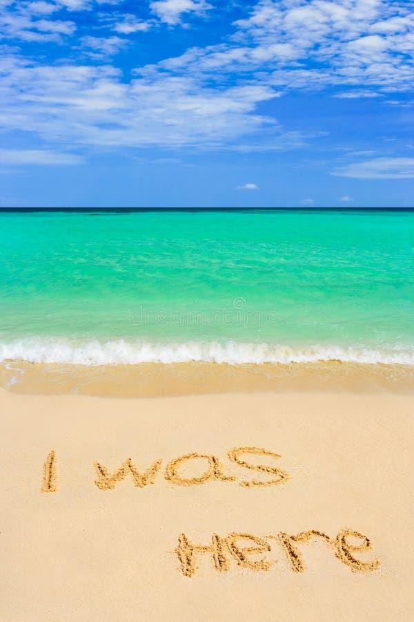 Palavras eu estava aqui na praia fotografia de stock royalty free