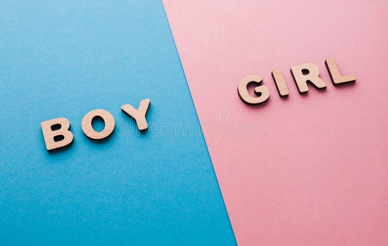 Palavras menino e menina em fundos brilhantes imagem de stock royalty free