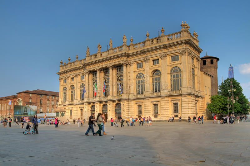 Palazzo Madama, Turin, Italy. Turin, Italy - April, 21st 2011: Tourists and locals alike enjoying a fine spring day in front of Palazzo Madama, Turin, Italy stock images