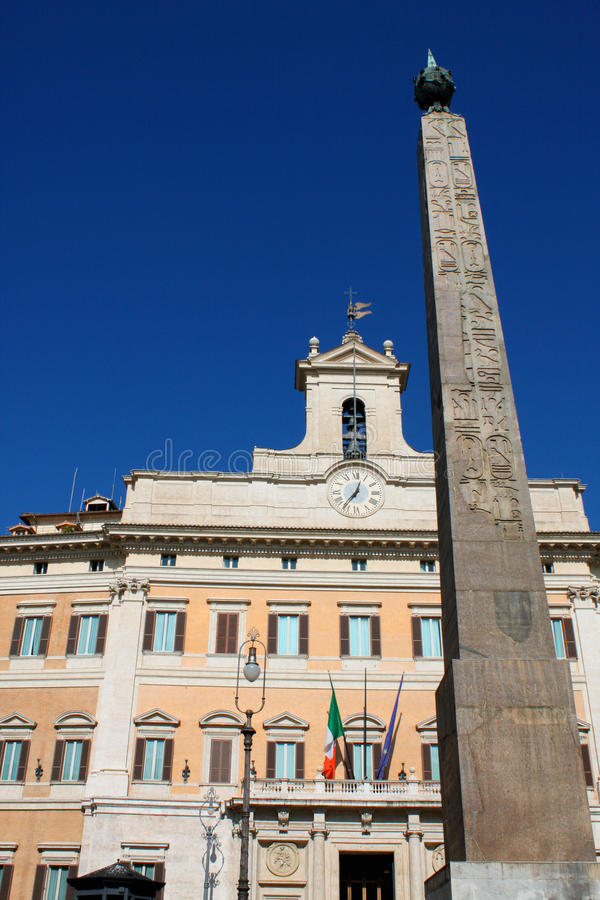 Palazzo Montecitorio is a palace in Rome and the seat of the Italian Chamber of Deputies. stock images