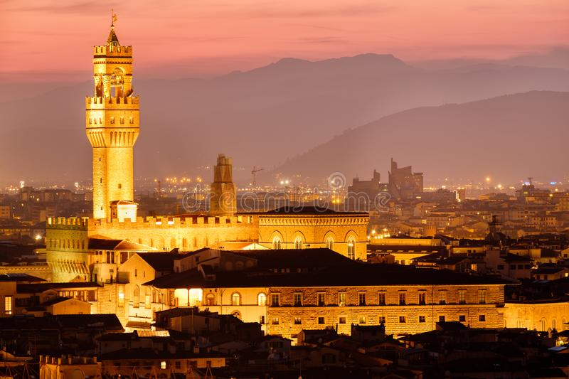 The Palazzo Vecchio and the historic centre of Florence at sunset. The Palazzo Vecchio and the historic centre of Florence illuminated at sunset royalty free stock images