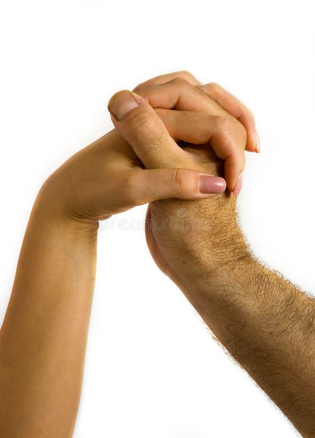 Palce kobieta i samiec wręczają przeplatanego fotografia royalty free