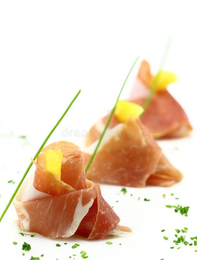 palcowego jedzenia prosciutto zdjęcie stock