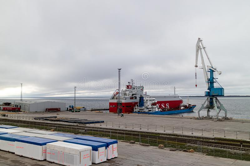 Paldiski / Estonia - 11.05.2018: view to sea harbour crane. Ship and containers stock photography