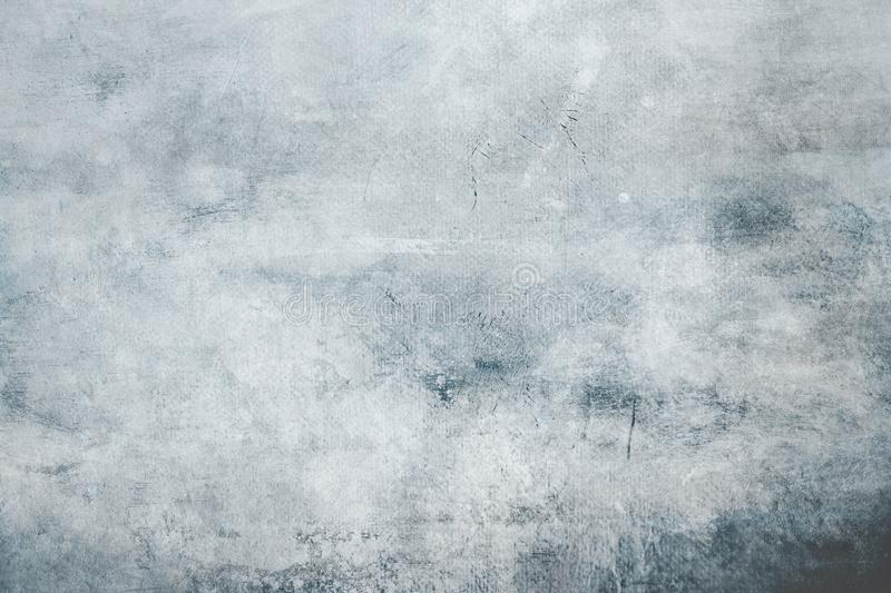 Pale blue grungy canvas background. Gray grungy canvas background or texture with dark vignette borders stock photography
