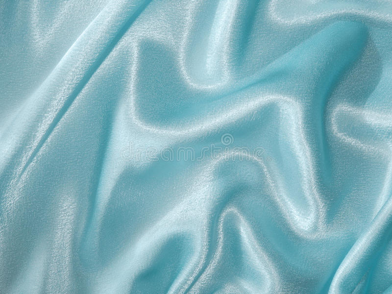 Pale blue satin with drapery - fabric background stock photos