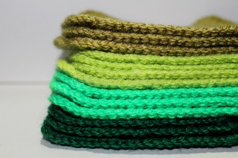 A pale of bright knitted elements royalty free stock photos