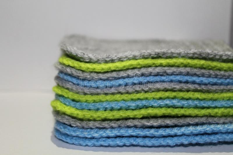 A pale of bright knitted elements stock photo