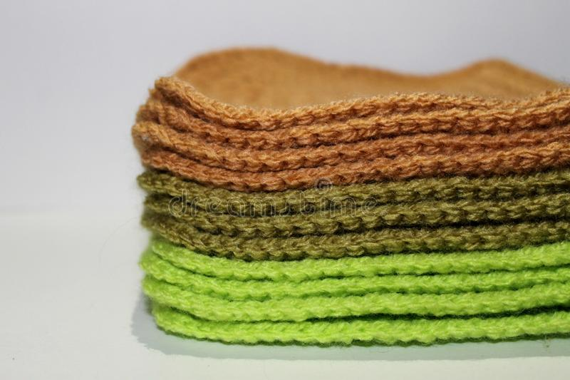 A pale of bright knitted elements royalty free stock photo