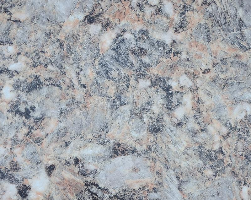 Pale gray marble with white and black spots, polished surface of natural stone close-up. Background stock photography