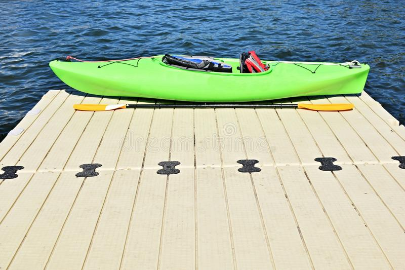 Pale Green Kayak on pier stock photos