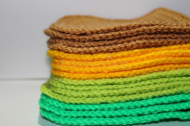A pale of bright knitted elements royalty free stock images