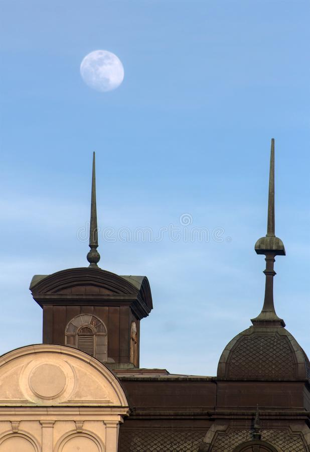The pale moon over the towers above a historic building. This beautiful view of harmony between the sky and the urban environment is in the center of Sofia stock photography