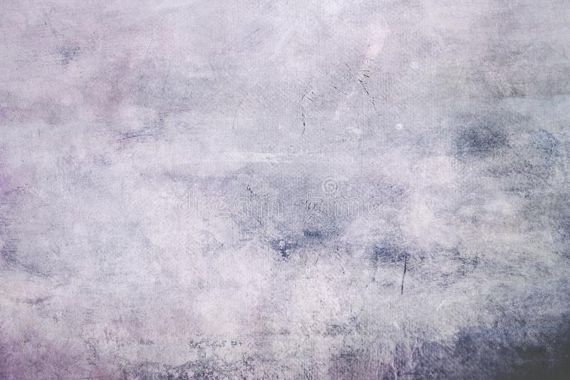 Pale purple grungy canvas background or texture with dark vignett stock images