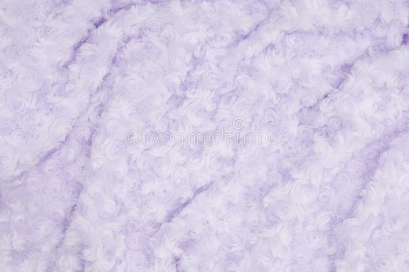 Pale purple rose plush fabric background. With muted mix of shades to provide copy-space for your message stock photo