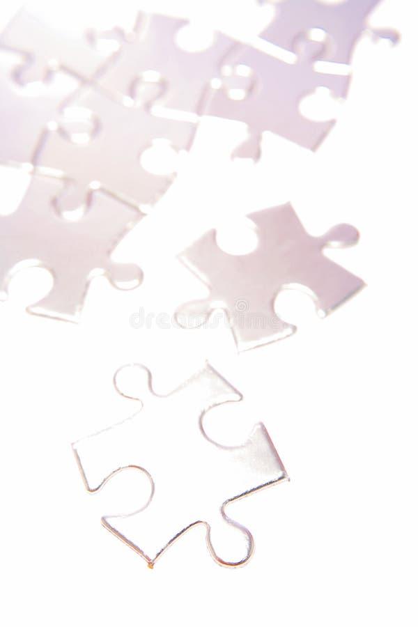Pale shiny puzzle pieces stock photo