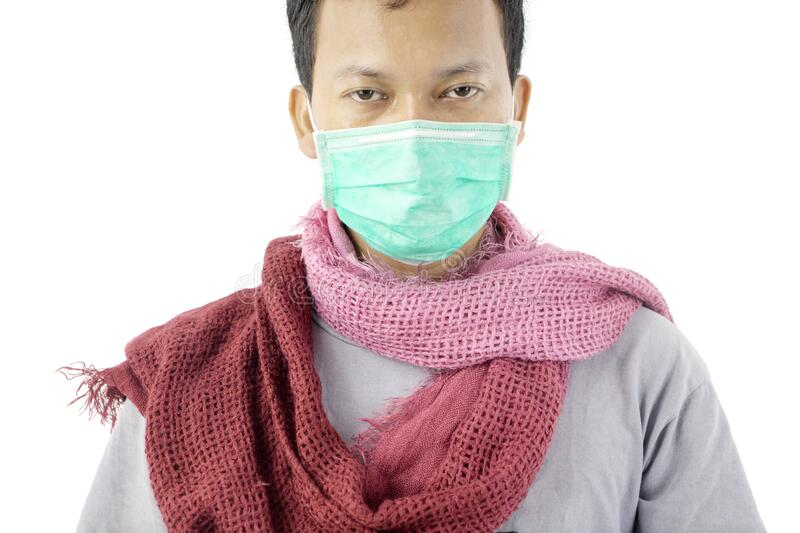 Pale unidentified man wearing mask and scarf royalty free stock photos