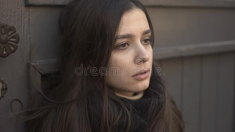 Pale young woman fainting on street, losing consciousness, health problems royalty free stock images