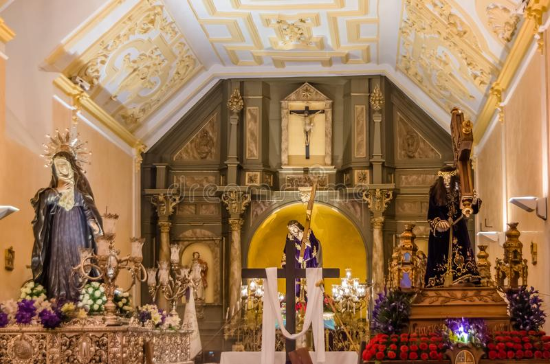 Exhibition of religious statues during the Holy Week in Palencia, Spain. PALENCIA, SPAIN - MARCH 24, 2016: Exhibition inside the Chapel of the Brotherhood of stock photography