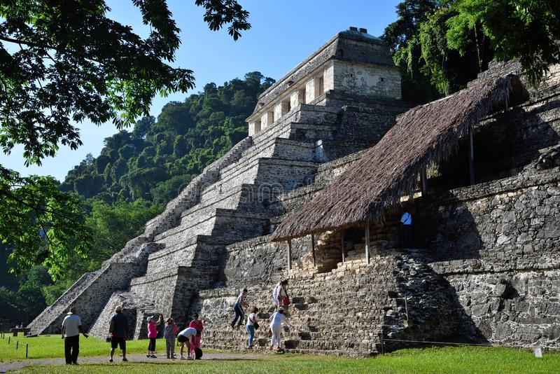 Palenque. Temple of the Inscriptions. Tourists near the Temple of the Inscriptions in ancient Maya site Palenque. The Temple of Inscriptions had begun perhaps royalty free stock photo