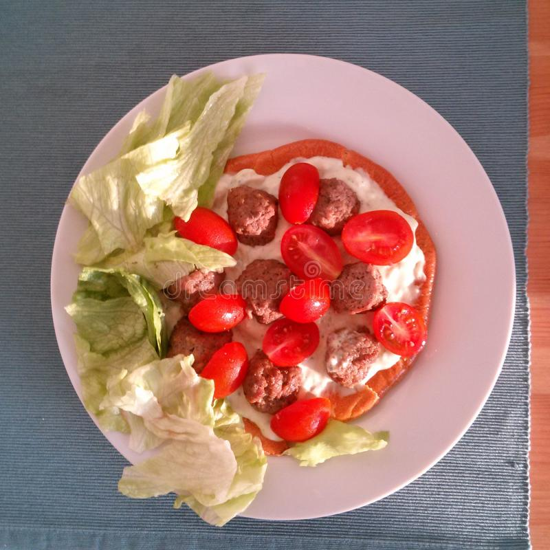 Paleo breakfast with tomatos, salad, meat balls and cream royalty free stock photography