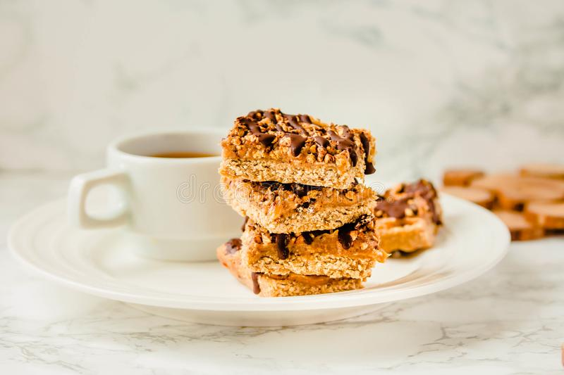 Paleo chocolate energy bars with rolled oats, nuts, dates caramel, chia seeds and coconut flakes. stock image