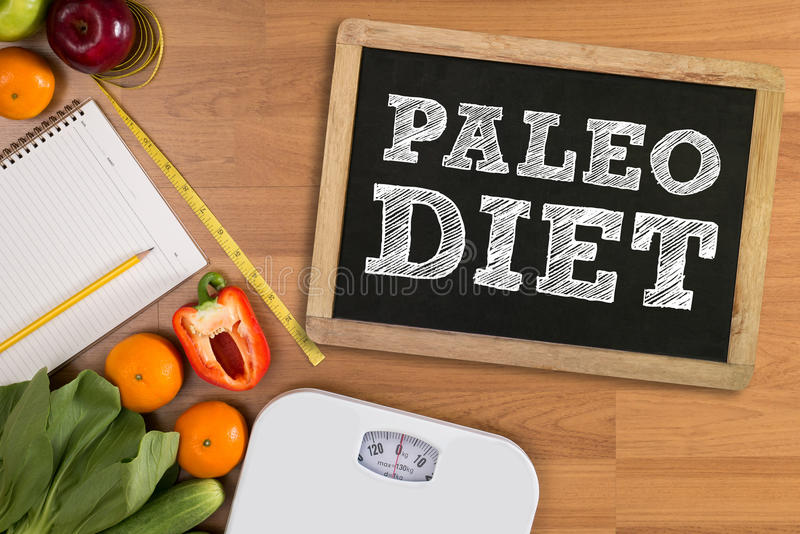 PALEO DIET ( Fitness and weight loss concept, fruit and tape measure on a wooden table, top view). PALEO DIET Fitness and weight loss concept, dumbbells, white royalty free stock photo