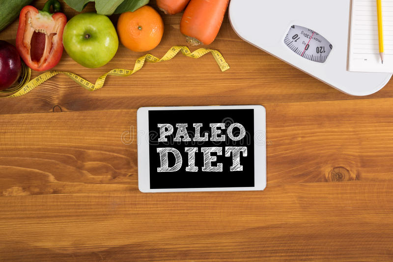PALEO DIET ( Fitness and weight loss concept, fruit and tape measure on a wooden table, top view) royalty free stock photos