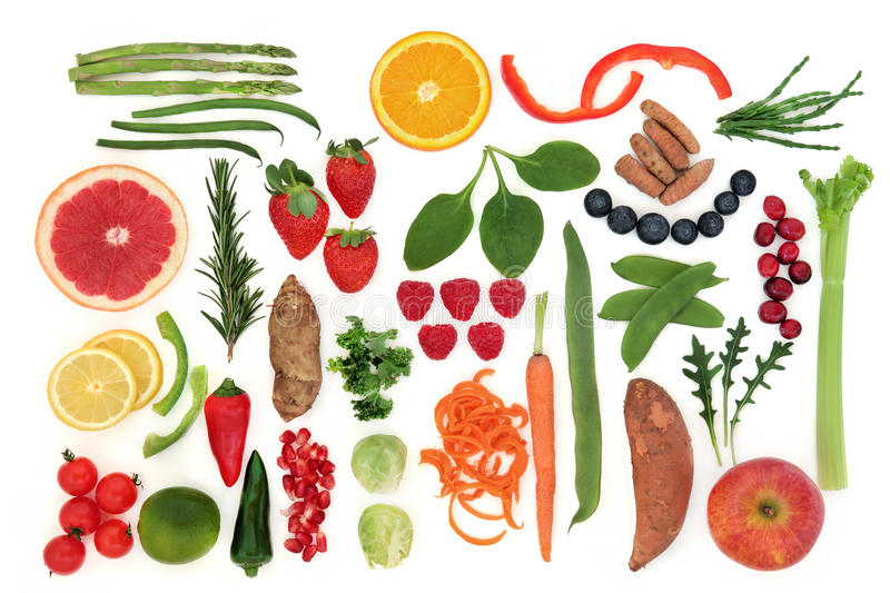 Paleolithic Diet Food. Paleolithic diet health food of fruit and vegetables over white background. High in vitamins, antioxidants, minerals and anthocyanins stock photography