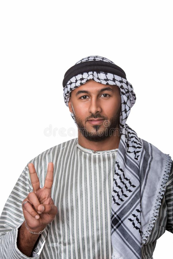 Palestinian Arab man showing peace sign and standing against isolated white background. Portrait of a Palestinian Arab man showing peace sign and standing stock images