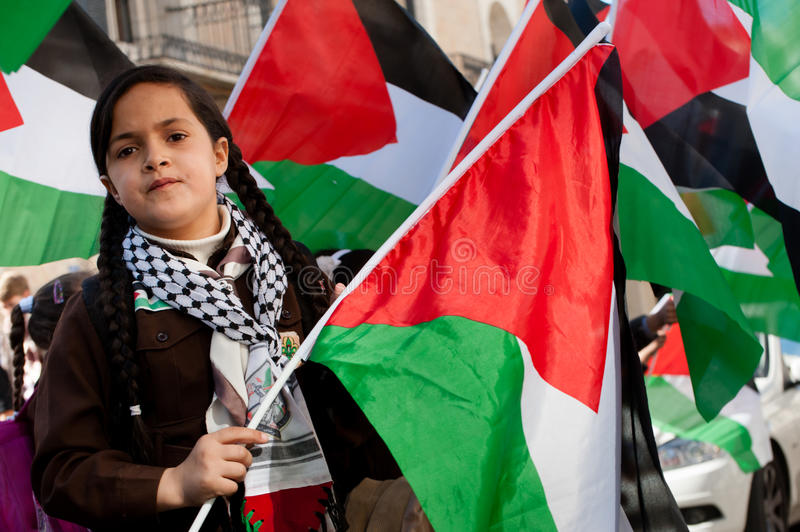 Palestinian girl scout and flags royalty free stock photos