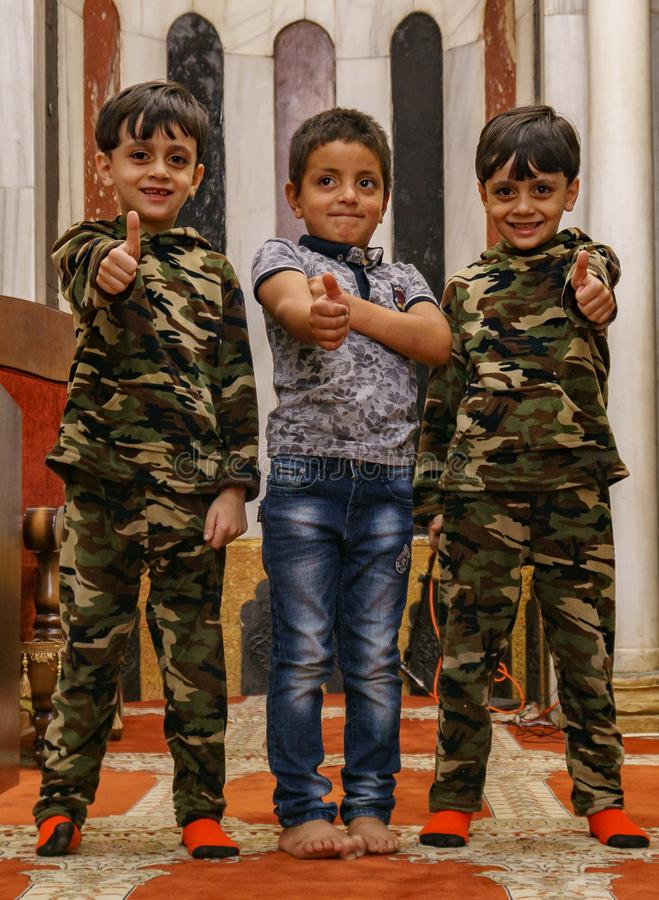 Palestinian kids show the sign of victory with their fingers inside the abraham mosque in hebron Al khalil in west bank in palesti royalty free stock photos