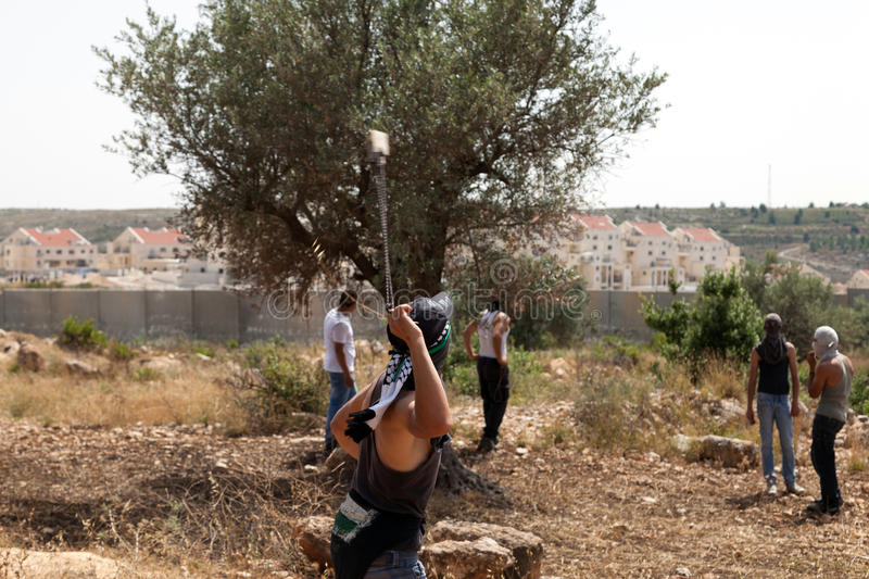 Download Palestinian Protester Shooting Rock At Protest Editorial Image - Image: 31088785