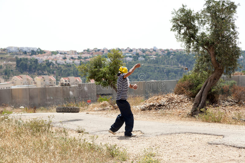 Download Palestinian Protester Shooting Rock At Protest Editorial Photography - Image: 31088897