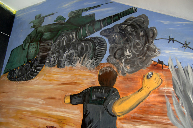 Palestinian Youth Art. September 14, 2006 - Art work on the wall of a school in Bethlehem, West Bank, depicts a Palestinian youth throwing rocks at an Israeli