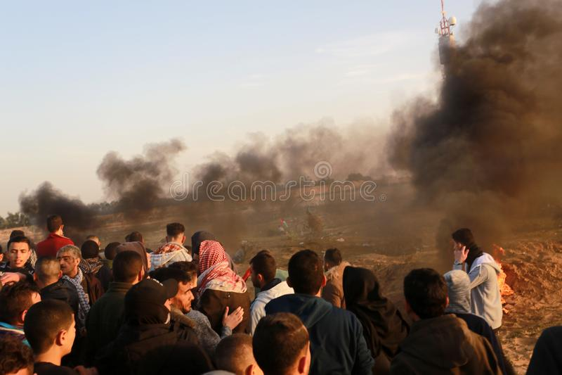 Palestinians take part in demonstration, on the Gaza-Israel border. Palestinians take part in a `Great March of Return` demonstration, on the Gaza-Israel border stock photo