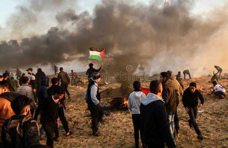 Palestinians take part in demonstration, on the Gaza-Israel border. Palestinians take part in a `Great March of Return` demonstration, on the Gaza-Israel border stock photography