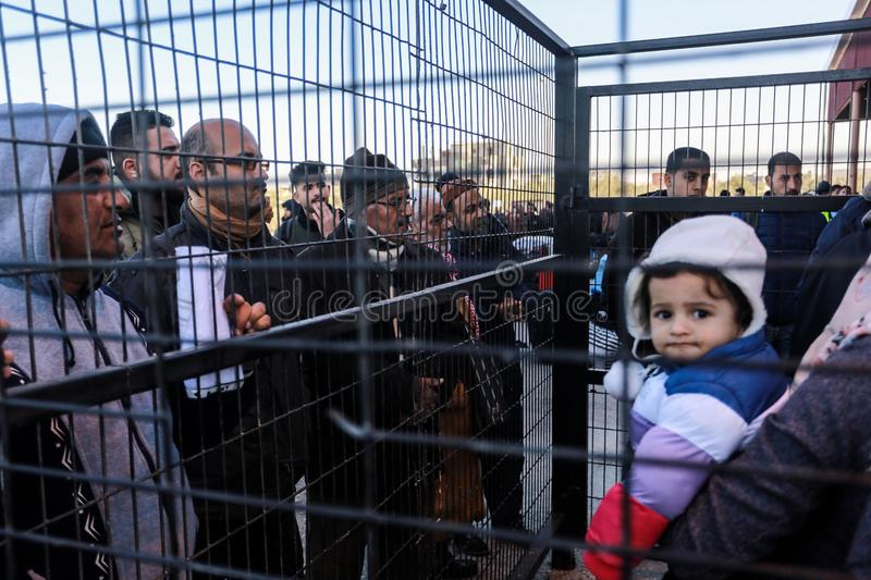 Egyptian authorities reopen the sole passenger crossing between Gaza and Egypt in both directions today. Palestinians wait to leave Gaza through Rafah border royalty free stock photo