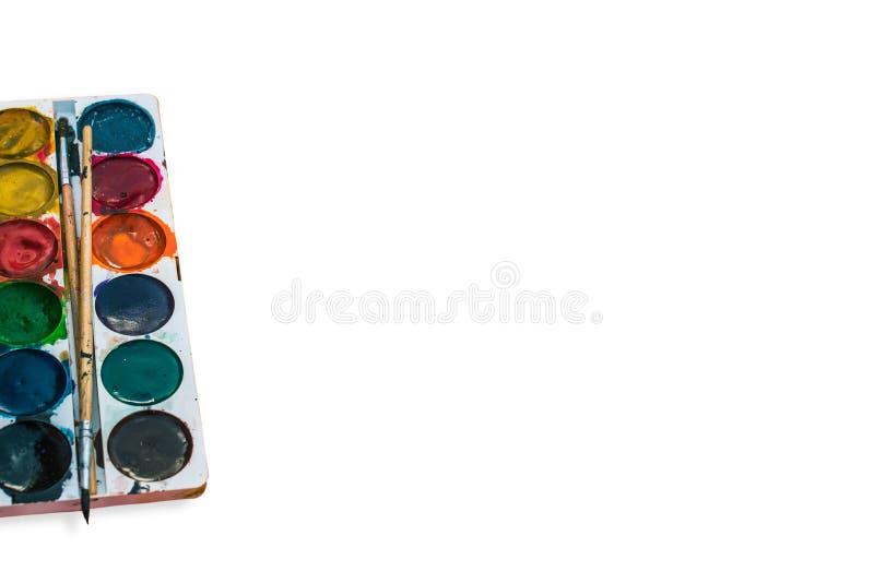Paleta akwarela obraz z muśnięciem na górze go na białym tle Akwareli paleta z muśnięciami na nim fotografia royalty free