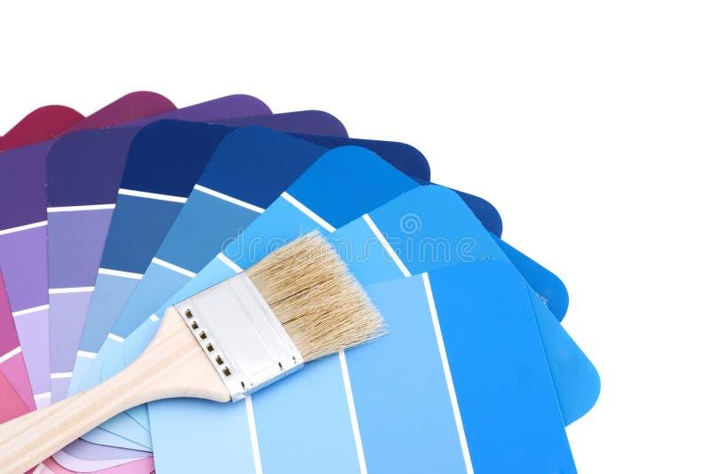 Paleta azul com escova fotografia de stock royalty free