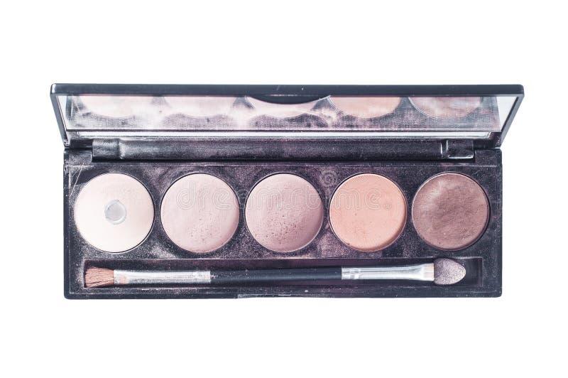 Paleta con diversas sombras de las sombras de la cara y del aplicador del cepillo para el uso El maquillaje fijó con un espejo en fotos de archivo