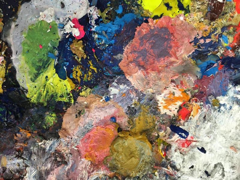 Paleta de los artistas de la pintura manchada fotos de archivo