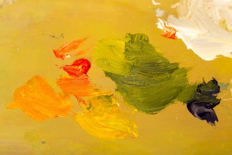 Paleta del ` s del artista Conveniente como fondo Rojo, oro, verde, blanco foto de archivo