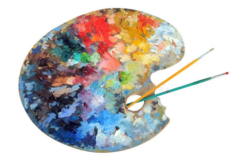 Paleta do artista com pincéis fotografia de stock