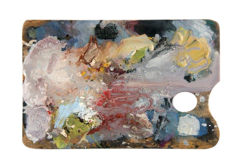 Paleta do ` s do artista com cores múltiplas isolada no fundo branco foto de stock
