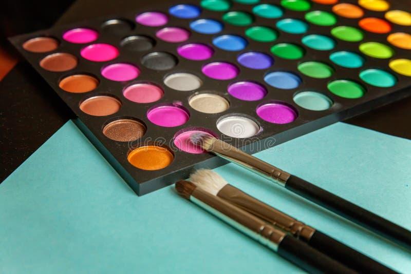 Paleta e escovas da composição imagem de stock
