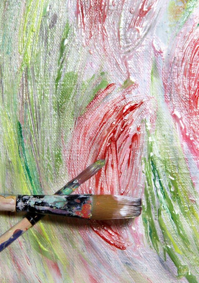 Paleta, pincéis e imagem da arte com flores imagens de stock